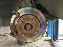 Closeup brake discs of the vehicle for repair. Closeup brake discs of the vehicle for repair royalty free stock images
