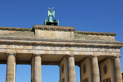 Closeup of Brandenburg gate in Berlin, Germany. Brandenburg gate against blue sky in Berlin, Germany royalty free stock photo