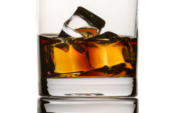 Closeup brandy with glass and ice cubes Stock Images