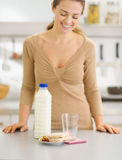 Closeup on breakfast of young woman in kitchen Royalty Free Stock Image