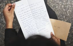 Closeup of breakup letter. Handhold Royalty Free Stock Photography