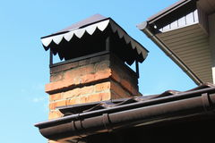 Closeup brick chimney on the roof Stock Image