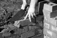 Bricklayer build house extension. Royalty Free Stock Photography