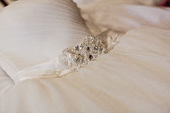 Closeup of a bridal garter with lace trim and blue satin bow Royalty Free Stock Images