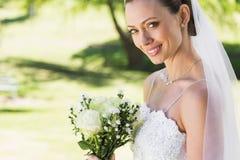 Closeup of bride with bouquet in garden Stock Photos