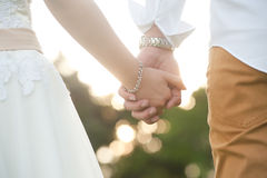 Closeup of Bride and groom holding hands Stock Photography