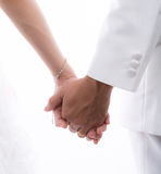 Closeup of bride and groom holding hands isolated on white back Royalty Free Stock Image