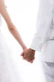 Closeup of  bride and groom holding hands Stock Photo