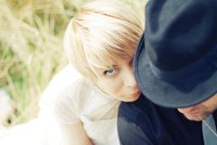 Closeup bride and groom sitting on the grass Stock Image