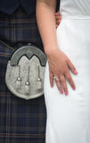 Closeup of Scottish Bride and Groom Wearing a Kilt at Wedding. Closeup of  Bride and Groom Wearing a Kilt at Wedding in Scotland Royalty Free Stock Photo