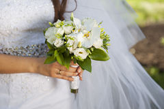 Closeup of bride hands holding beautiful wedding bouquet Stock Photos