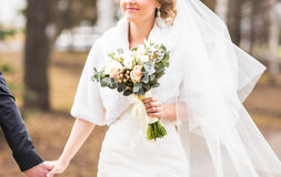 Closeup of bride hands holding beautiful wedding bouquet Royalty Free Stock Image
