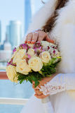 Closeup of bride hands holding beautiful wedding bouquet Stock Photography