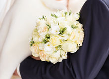 Closeup of bride hands holding beautiful winter wedding bouquet Royalty Free Stock Image