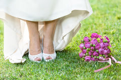 Closeup bride holding bouquet of roses Stock Photo