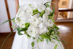 Closeup bride holding bouquet of white roses Royalty Free Stock Photos