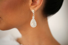 Closeup with bride`s elegant crystal ear rings. Closeup with bride`s elegant crystal ear ring stock photography