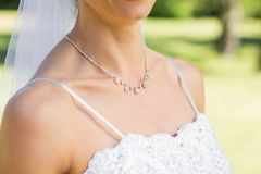 Closeup of bride wearing necklace in garden Royalty Free Stock Photo