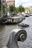 Closeup of bridge ornament closeup, boats on Amstel, Amsterdam Royalty Free Stock Image