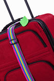 Luggage tag and belt on suitcase Stock Image