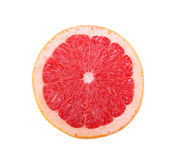 Closeup of bright juicy grapefruit. A round red citrus fruit with an acid, juicy pulp isolated on a white background. Closeup of bright sappy grapefruit. A round Royalty Free Stock Photo