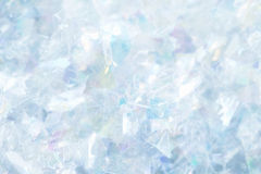 Closeup of Bright Silver/Blue Confetti. Sharp, textured surface of blurred silver confetti Stock Images
