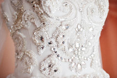 Closeup of brilliant and stones on wedding dress Stock Photography