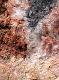 Closeup of a broken stone which contains various colored mineralsvarious Royalty Free Stock Image