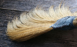 Closeup of broom on wooden Royalty Free Stock Images