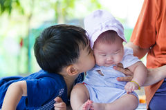 Closeup brother and sister having happy together, brother kissin Stock Images