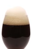 Closeup of brown beer glass with foam. Stock Photo