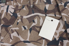 Closeup brown camo pocket shorts / pants with tag  Stock Images