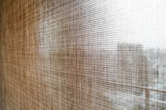 Closeup brown color roller blinds curtains. Stock Photography
