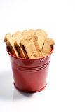 Closeup of brown dog treats. In a red bucket Stock Photo