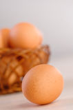 Closeup brown eggs wicker basket Royalty Free Stock Photo