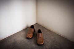 Closeup Brown leather shoes walk out of corner Royalty Free Stock Photo