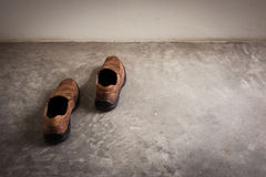 Closeup Brown leather shoes walk in wall Stock Image