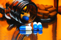 Capsules and Medicine Bottles Stock Images