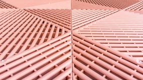 Brown plastic rods as a permeable walkway plate for growth of the lawn royalty free stock images