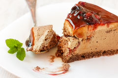 Brown sliced cake on white plate Stock Image