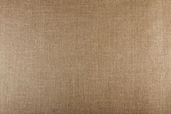 Closeup of brown textured surface, burlap texture background. Royalty Free Stock Photos