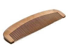 Closeup brown wooden comb on background. Closeup brown wooden comb on a white background Stock Images