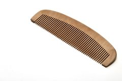 Closeup brown wooden comb on a white. Background Royalty Free Stock Images