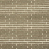 Closeup of brownish green brick wall as background or texture Royalty Free Stock Photo