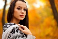 Closeup brunette in autmn park Royalty Free Stock Images