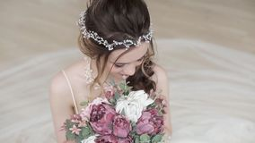 Closeup brunette bride with fashion wedding hairstyle and makeup stock video footage