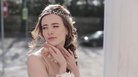 Closeup brunette bride with fashion wedding hairstyle and makeup stock footage