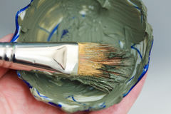 Closeup brush and green clay facial mask in bowl. Skin care. Closeup brush and green clay facial mask in bowl Royalty Free Stock Photography