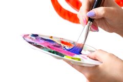 closeup brush and palette in the hands of the painter artist, watercolor painting royalty free stock photos