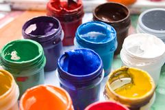 Closeup of buckets with colorful paints in rows Stock Photography